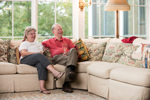 Senior couple relaxing on sofa after healthy meal