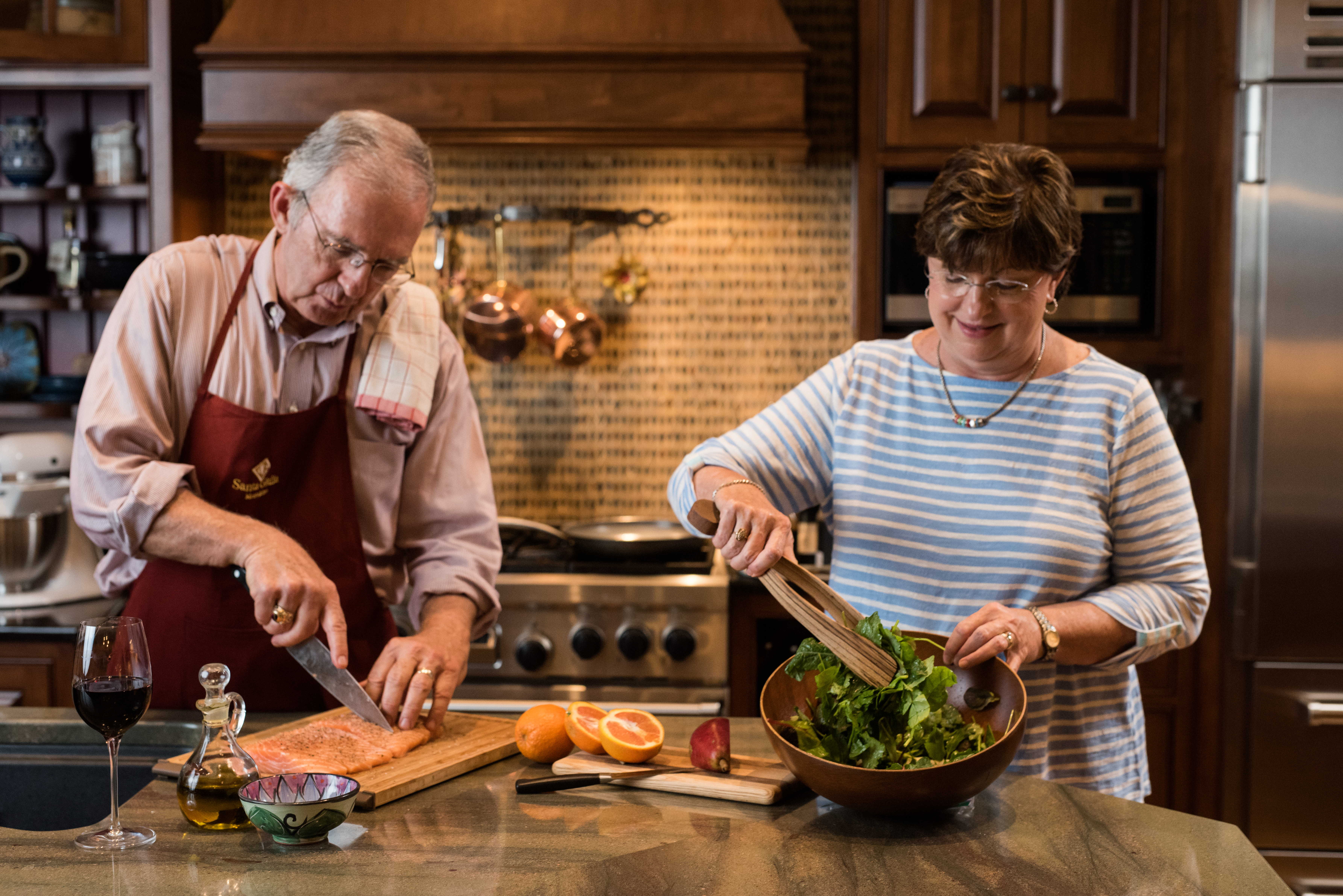 Senior couple making healthy recipe together