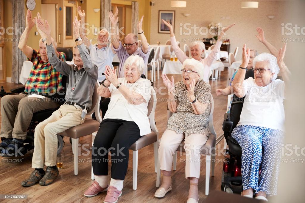 retirement home seniors applauding